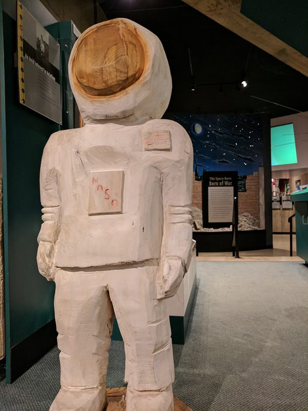 Astro the wooden museum mascot