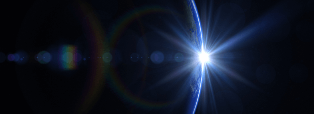 Sun peaking around the Earth in space